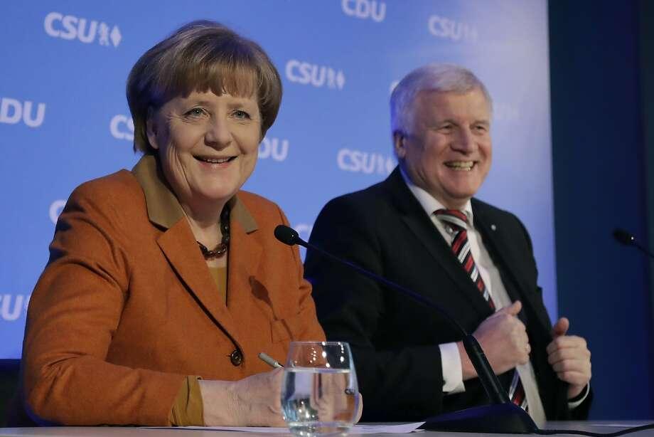 German Chancellor Angela Merkel and Bavarian Gov. Horst Seehofer meet in Munich in a show of political unity. Photo: Matthias Schrader, Associated Press