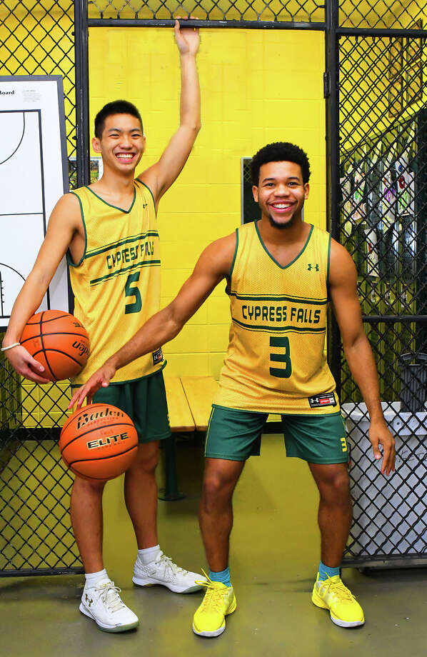 Cy Falls junior point guards Andrew Nguyen (left) and Trajan Wesley (right) are flying a little bit under the radar, despite the Golden Eagles' success this season. Both are talented, high-impact ball-handlers and scorers who manage the team's plethora of weapons capably and effectively. Photo: Tony Gaines / HCN