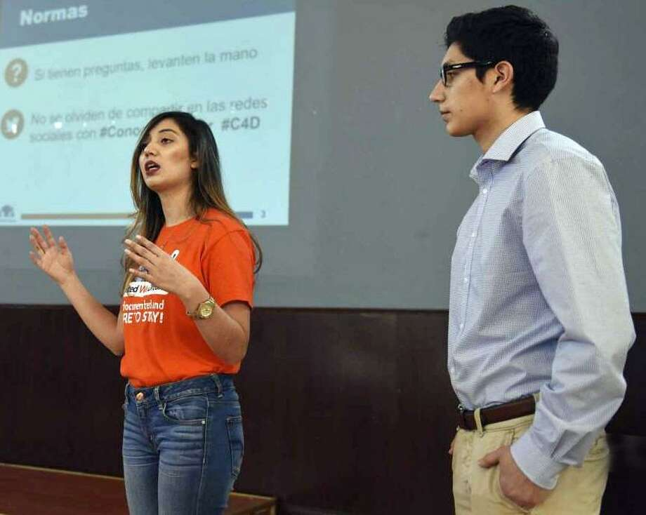 CT Students for a Dream Community Organizer Angelica Idrovo and Pablo Idrovo speak at the Ecuadorian Civic Center in Danbury in mid-January. Photo: / Tyler Sizemore