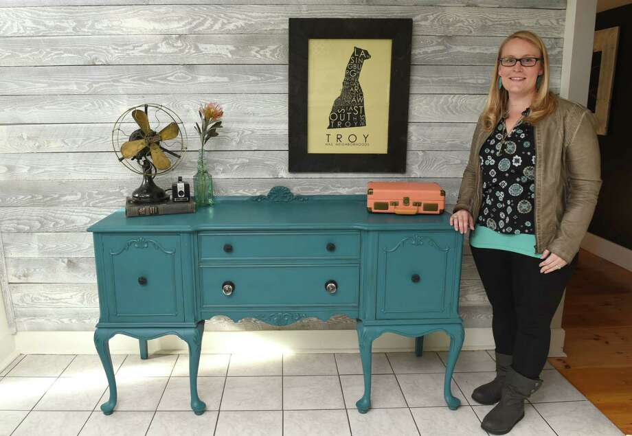Sarah Trop in her home next to a teal buffet from FunCycled on Friday Nov. 11, 2016 in Wynantskill, N.Y. (Michael P. Farrell/Times Union) Photo: Michael P. Farrell / 20038675A