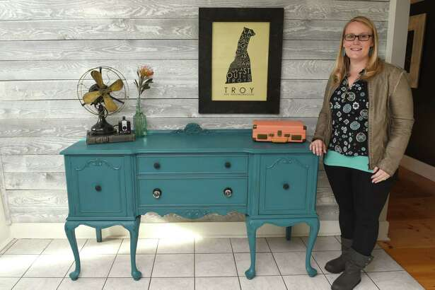 Sarah Trop in her home next to a teal buffet from FunCycled on Friday Nov. 11, 2016 in Wynantskill, N.Y. (Michael P. Farrell/Times Union)
