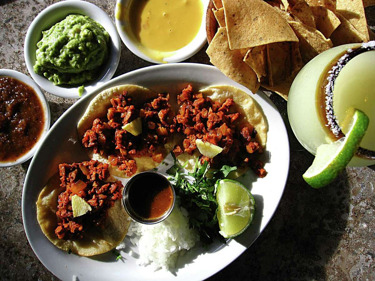 Happy hour specials at Paloma Blanca on Broadway include queso and guacamole, tacos al pastor and frozen margaritas.