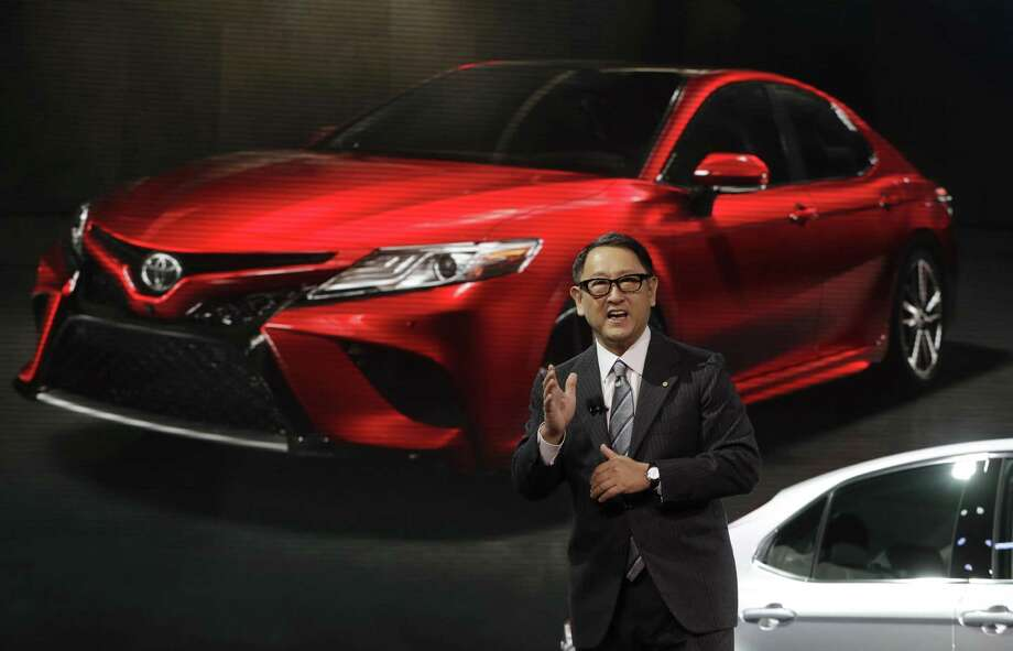 President Akio Toyoda introduces the 2018 Toyota Camry at the North American International Auto show in Detroit earlier this year. Toyota Motor Corp. said Monday its profit fell 23 percent in the October-December quarter from a year earlier as its sales fell and a stronger yen bit into its overseas earnings. Photo: Carlos Osorio /Associated Press / Copyright 2017 The Associated Press. All rights reserved.