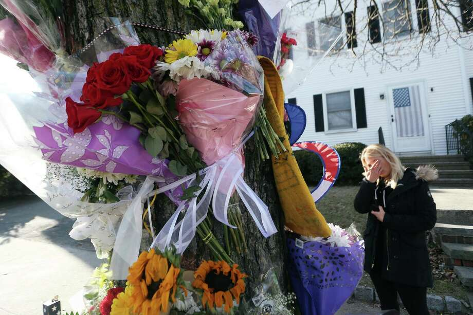 A friend of the two people killed in a car accident over the weekend wipes away a tear while standing in front of a memorial on Hope St. in Stamford, Conn. on Monday, Feb. 6, 2017. Photo: Michael Cummo / Hearst Connecticut Media / Stamford Advocate