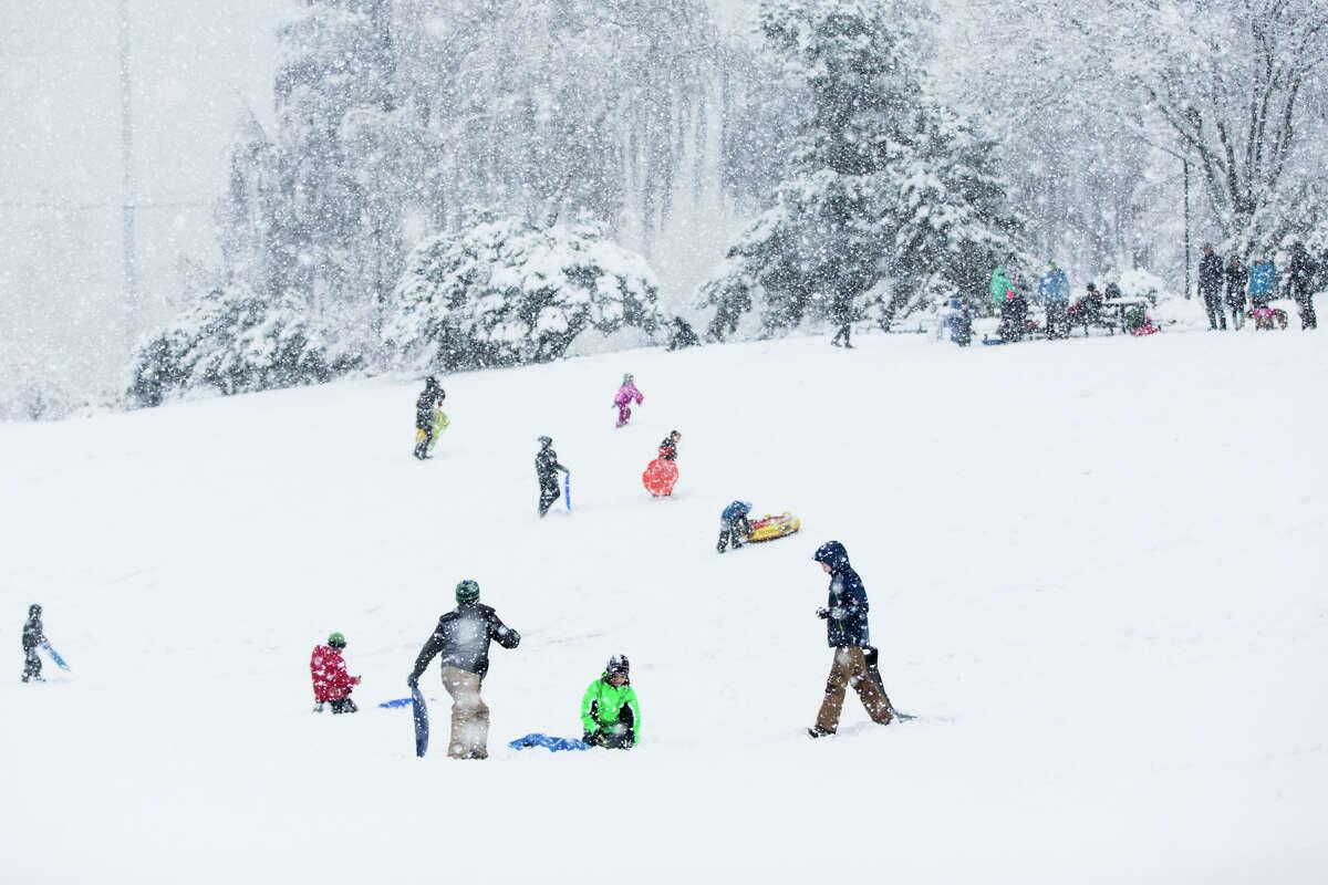 Kids take advantage of a snow day on a hill at Jefferson Park on Monday, Feb. 6, 2017.
