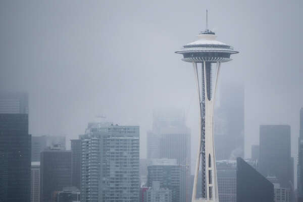 The snow-covered Space Needle stands out from a particularly gray Seattle on Monday, Feb. 6, 2017.