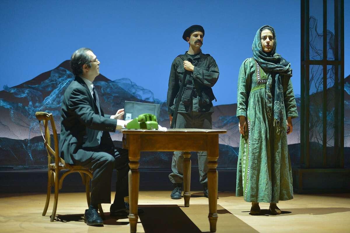 "An interrogator (Barzin Akhavan, left) questions Laila (Nadine Malouf) about her travel plans in ACT's ""A Thousand Splendid Suns."""