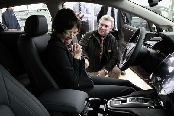 Heather Mc Laughlin, of San Ramon, takes delivery of its first of its kind hydrogen fuel-cell cars the Honda Clarity with the help from Mark Burda, the Clarity brand ambassador, at Dublin Honda,  on Monday Feb. 6, 2017, in Dublin, Ca.