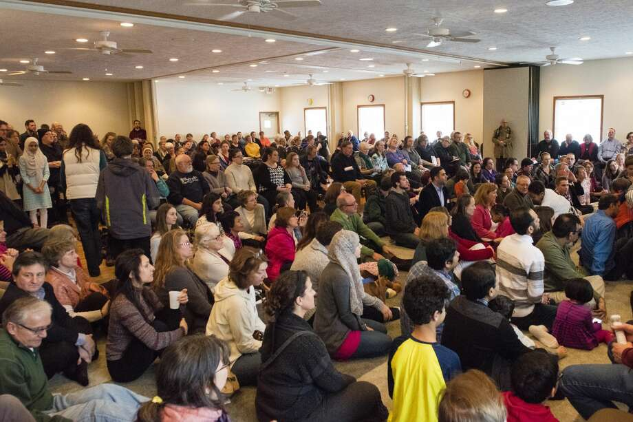 """More than 400 people attended the event to learn about Muslim perspectives on the recent executive order at the Islamic Center of Midland Meet and Greet on Sunday. """"I'm completely blown away. We expected a large turnout, but I don't think anybody in the community was prepared for the type of turnout that we actually ended up having,"""" said Umbareen Jamil, one of the organizers. Photo: DANIELLE McGREW TENBUSCH 