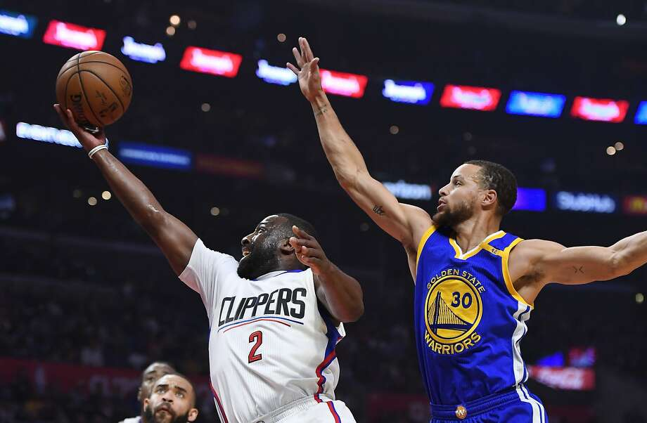 Los Angeles Clippers guard Raymond Felton, left, shoots as Golden State Warriors guard Stephen Curry defends during the first half of an NBA basketball game, Thursday, Feb. 2, 2017, in Los Angeles. (AP Photo/Mark J. Terrill) Photo: Mark J. Terrill, Associated Press