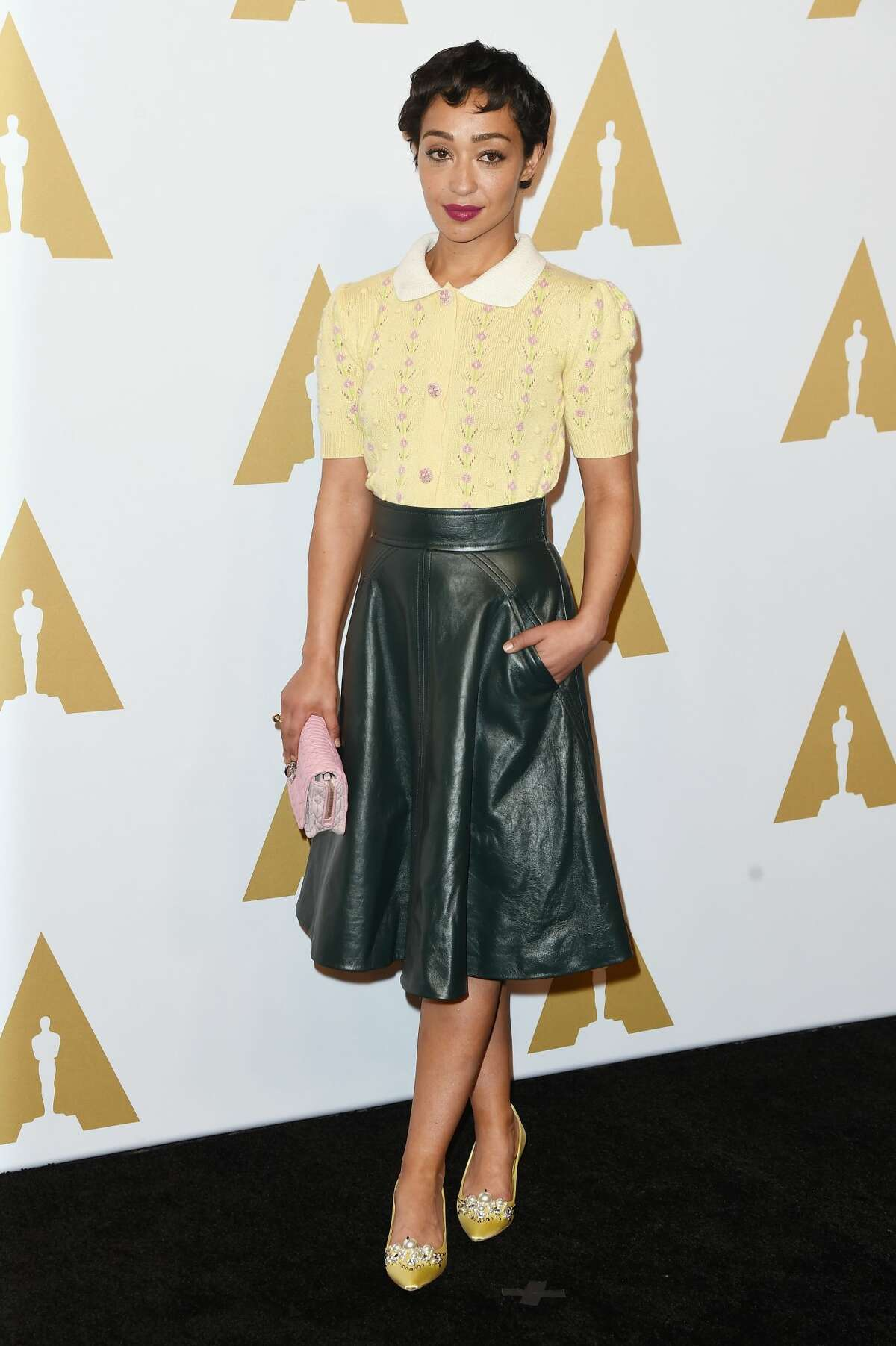 Ruth Negga Best:Negga kicks up this daytime look with a black leather midi skirt. The actress's jeweled yellow shoes are show stoppers.