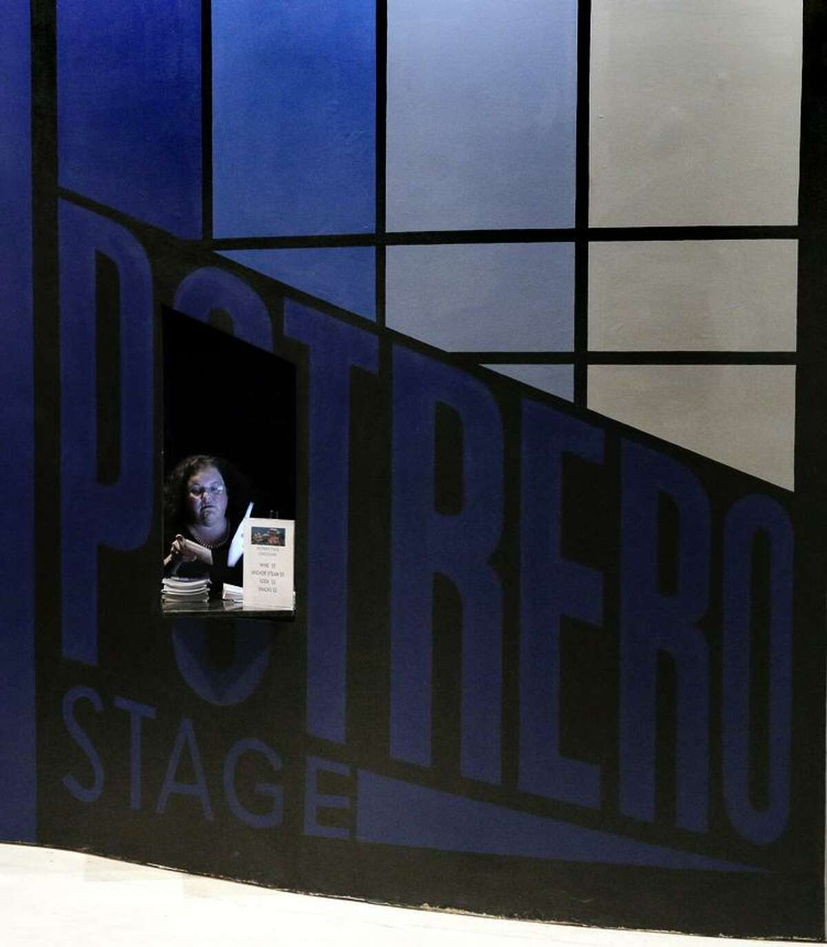 Associate Director Annie Stuart waits in the box office before a preview performance of the Potrero Nuevo Project.