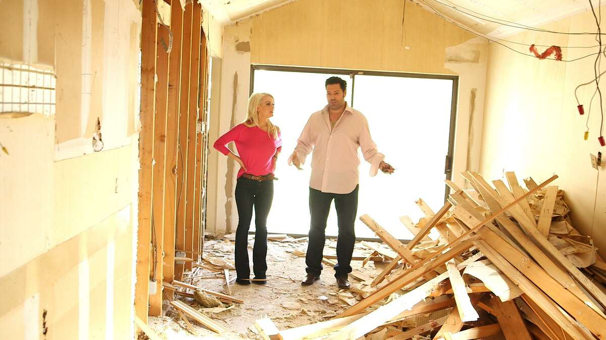 San Antonio house flipper and TV personality Armando Montelongo and his second wife Whittney survey a house in horrendous shape which is at the heart of a challenge on new reality series, 'Flipping Nightmares.'.