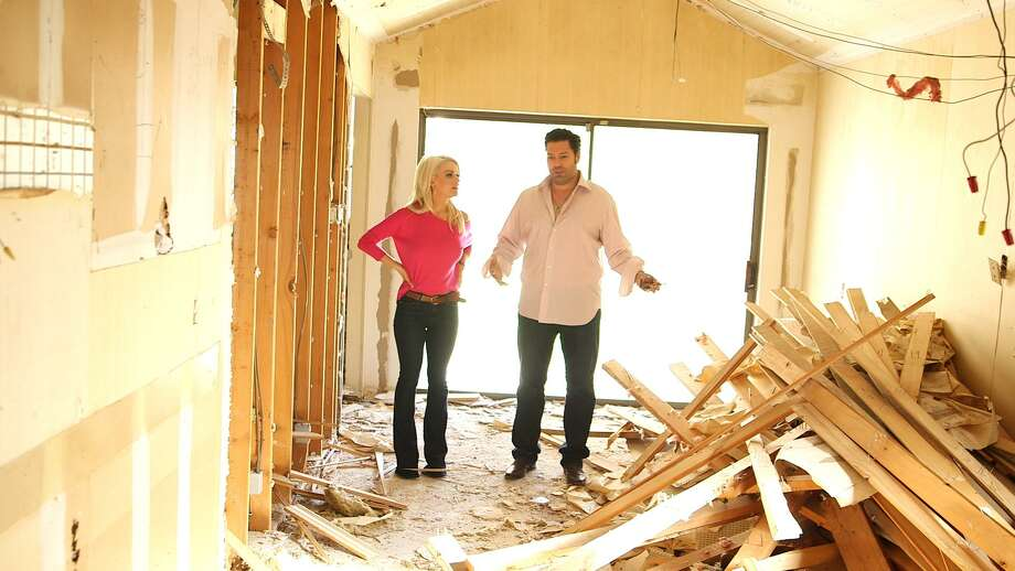 """San Antonio house flipper and TV personality Armando Montelongo and his wife, Whittney, survey a house in horrendous shape that is at the heart of a challenge on new reality series """"Flipping Nightmares."""" Photo: Courtesy Armando Montelongo Productions"""