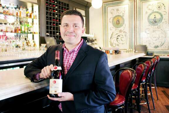 John Michael O'Shea, the beverage director for Dallas-based Lombardi Family Concepts, which owns Toulouse and Taverna in River Oaks District, with a bottle of 2012 E. Guigal Gigondas.