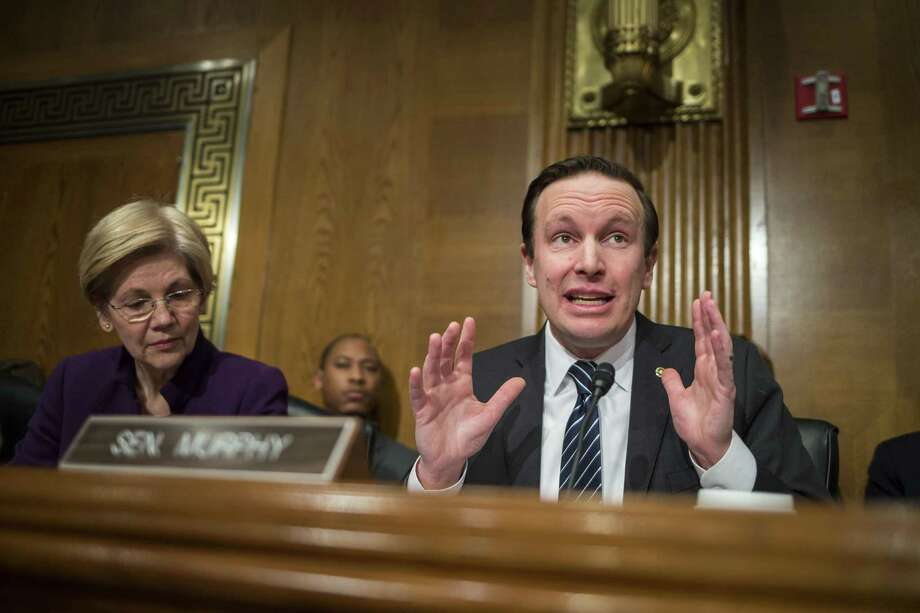 Sen. Chris Murphy (D-Conn.) and Sen. Elizabeth Warren (D-Mass.) during a confirmation hearing for Betsy DeVos, President Donald Trump's pick for education secretary, before the Senate Health, Education, Labor and Pensions Committee, on Capitol Hill in Washington, Jan. 31, 2017. Photo: Al Drago /The New York Times / NYTNS