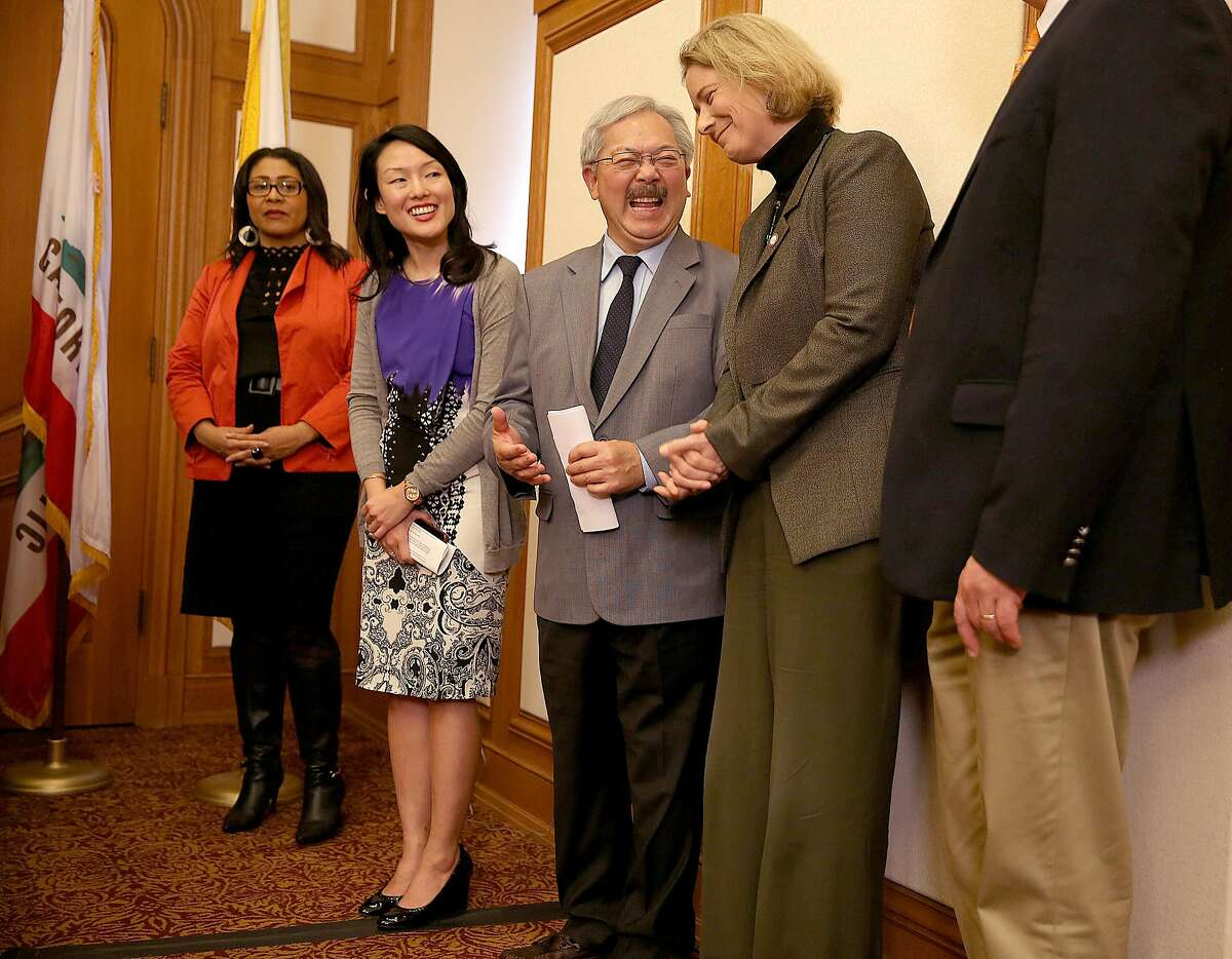 Supervisor Jane Kim (middle wearing purple), mayor Edwin Lee (middle), and City College of San Francisco acting chancellor Susan Lamb (middle right) announce that City College of San Francisco will be accessible for all California residents taking courses for credit next year on Monday, February 6, 2017, at city hall in San Francisco, Calif.