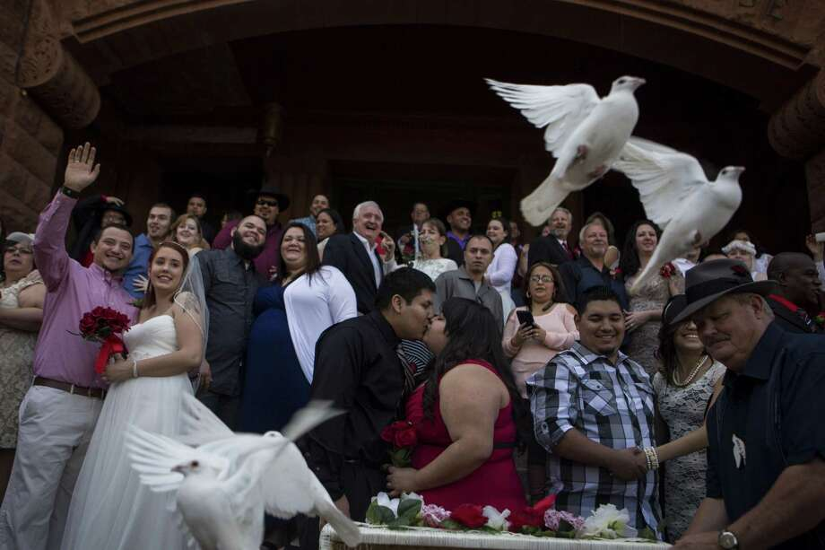 Twenty-five doves were released after one of the free mass wedding ceremonies held annually on the steps of the Bexar County Courthouse on Valentine's Day, Saturday, February 14, 2014.  Over 30 couples were married during that ceremony. Photo: Carolyn Van Houten, Staff / San Antonio Express-News / 2015 San Antonio Express-News