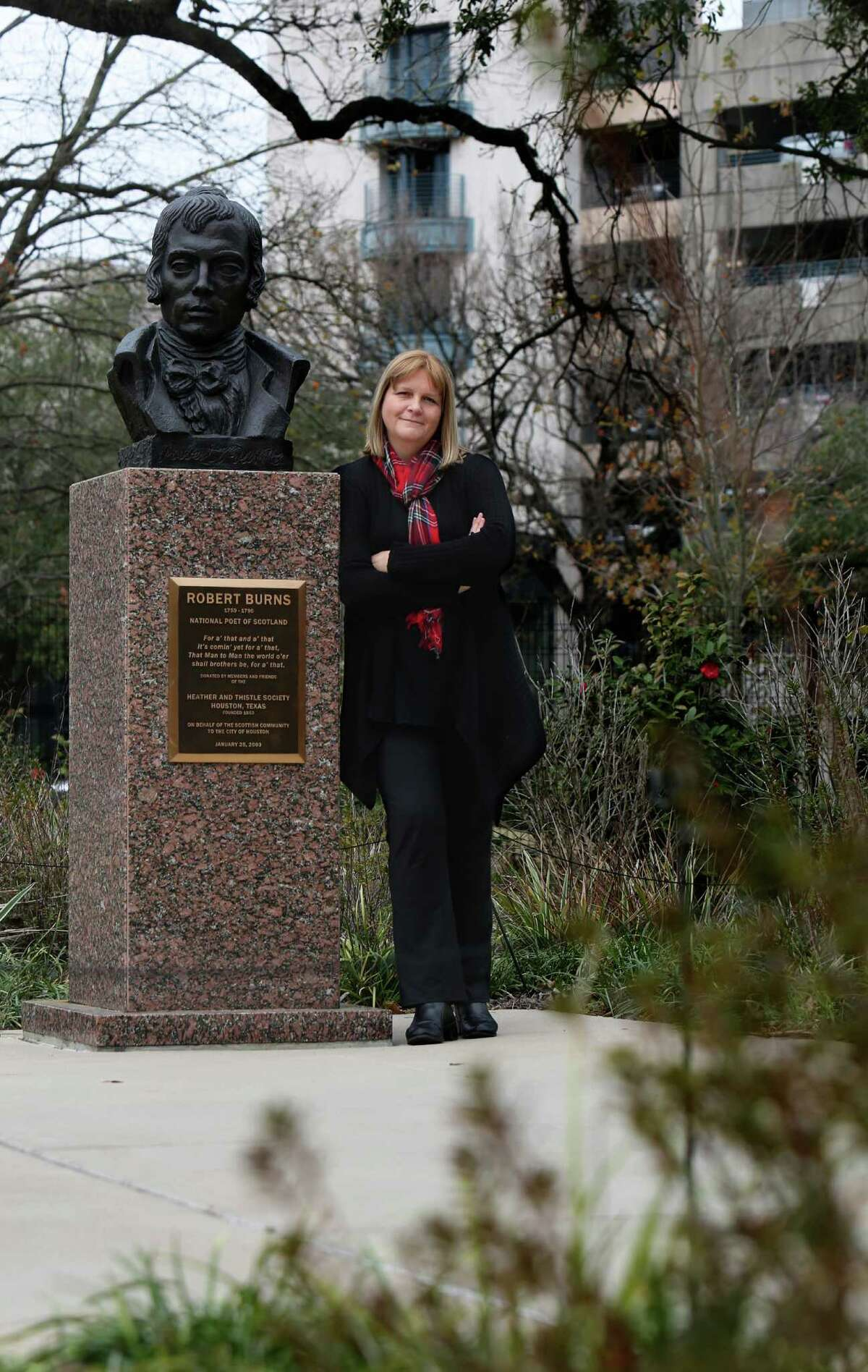Writer Caroline Leech stands next to a bust of Scottish poet Robert Burns in Houston. Leech has written a wartime romance set in Scotland, and references to the work of Burns pops up throughout the story.