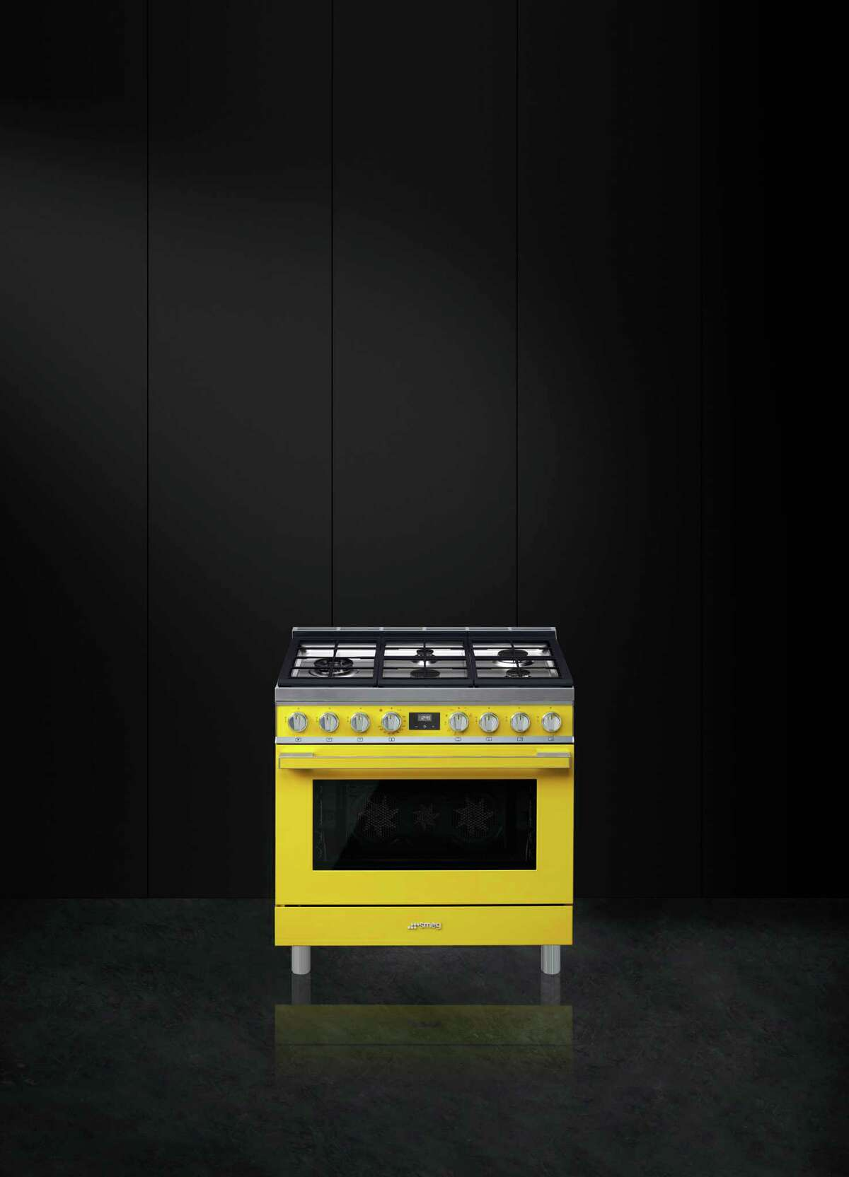 Smeg brand appliances now come in bright colors such as this yellow range. this year they'll launch a liine of matching range hoods that will sell for $3,999 ($3,499 for the stainless steel version).