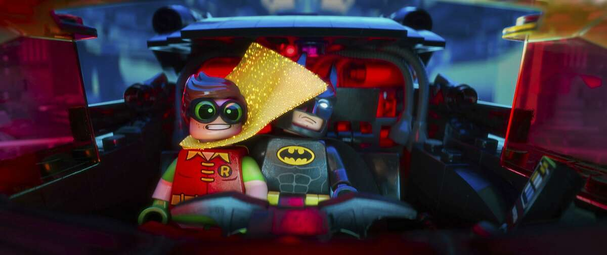Robin, voiced by Michael Cera (left) and Batman, voiced by Will Arnett.