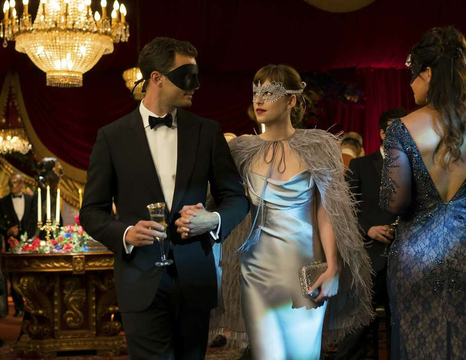 """This image released by Universal Pictures shows Jamie Dornan as Christian Grey, left, and Dakota Johnson as Anastasia Steele in """"Fifty Shades Darker."""" (Doane Gregory/Universal Pictures via AP) Photo: Doane Gregory, Associated Press"""
