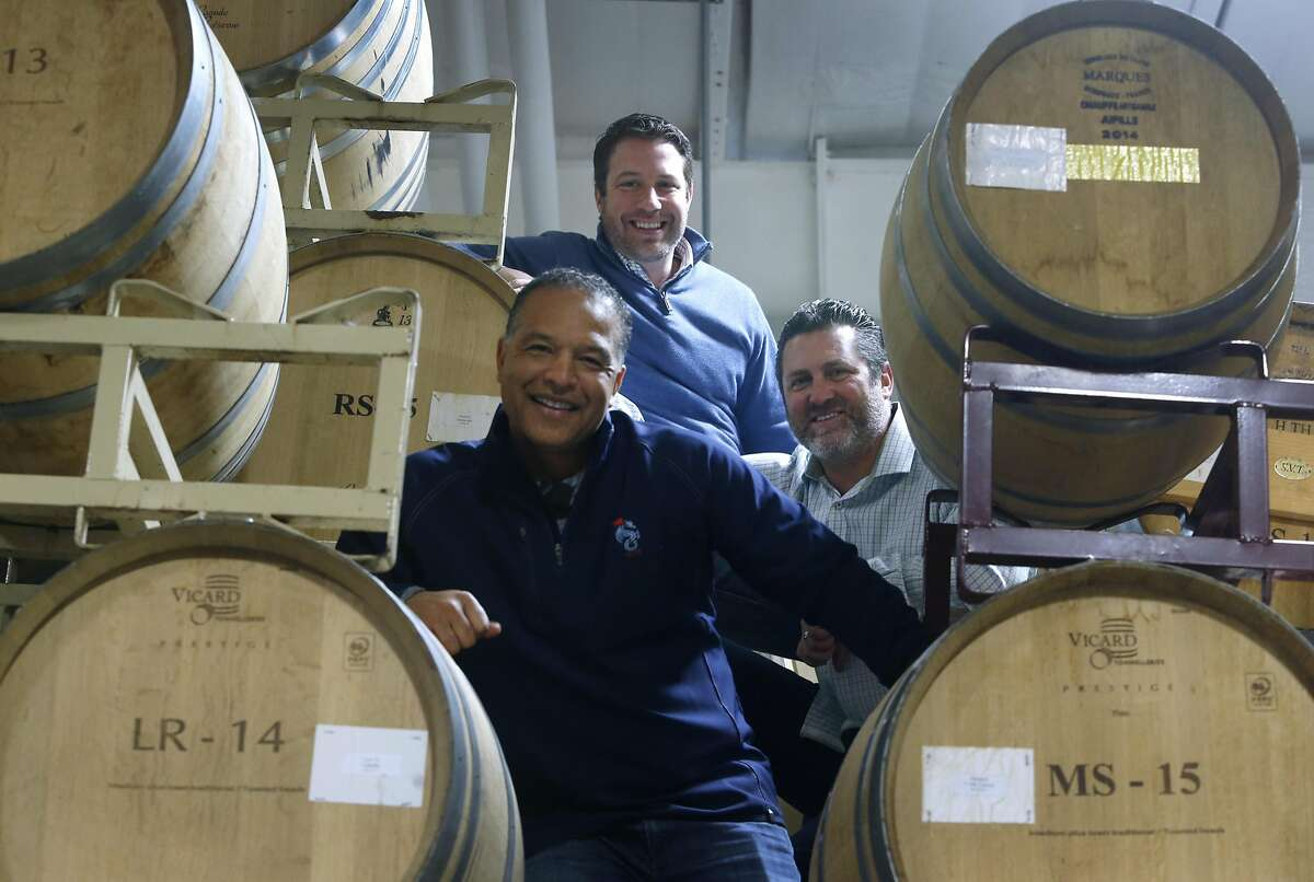The Red Stitch team of Dave Roberts (front), Rich Aurilia (right) and John Micek climb to the top of a rack of wine barrels after a tasting at the Mi Sueño Winery in Napa. Former Giants players Aurilia and Roberts (currently the manager of the Los Angeles Dodgers) teamed up with friend Micek and winemaker Rolando Herrera for their winemaking project.