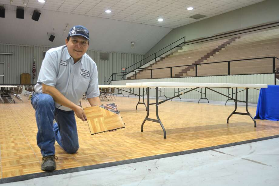 Ollie Liner Center Manager Benito Garcia shows a sample of the newly-installed snap-together special event flooring in the center's arena.