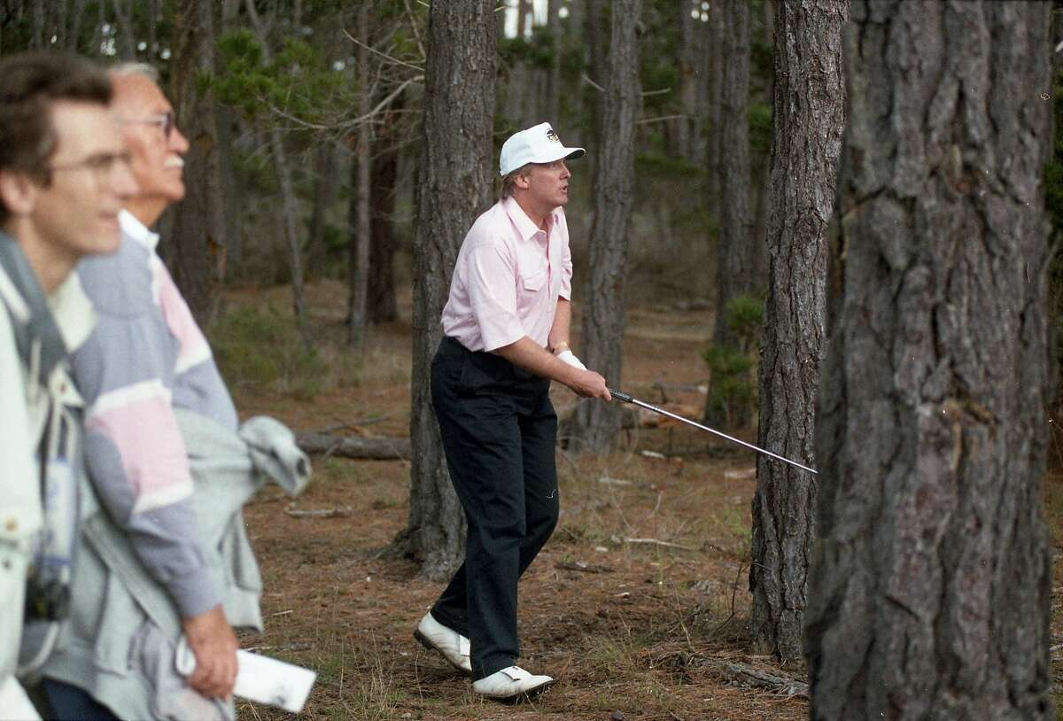 Donald Trump works his way out of the woods during the AT&T Pebble Beach Pro-Am on Feb. 4, 1993at the Poppy Hills course in Pebble Beach.