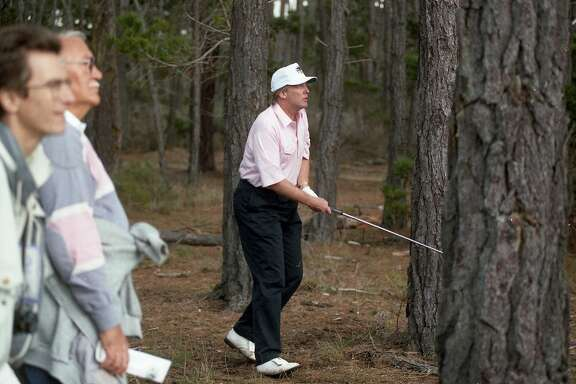 Feb. 4, 1993: Donald Trump works his way out of the woods during the AT&T Pebble Beach Pro-Am at the Poppy Hills course in Pebble Beach.