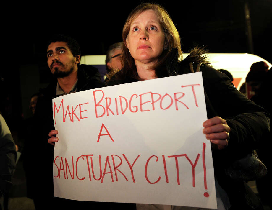 Ann McCarthy, of Fairfield, attends a rally to make Bridgeport a sanctuary city outside City Hall in Bridgeport, Conn. on Monday, February 6, 2017. The rally was organized by the group Make the Road Bridgeport. Photo: Brian A. Pounds, Hearst Connecticut Media / Connecticut Post