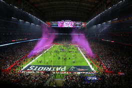Confetti fills the air after the New England Patriots defeated the Atlanta Falcons in Super Bowl LI at NRG Stadium on Sunday, Feb. 5, 2017, in Houston. ( Jon Shapley / Houston Chronicle )