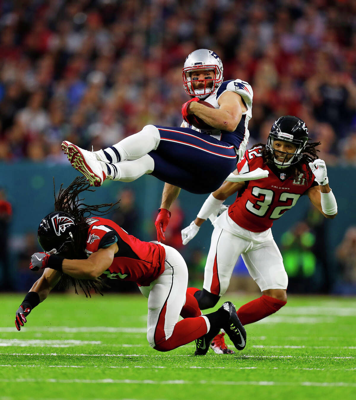 New England Patriots wide receiver Julian Edelman center, is upended during the first quarter of Super Bowl LI at NRG Stadium on Sunday, February 5, 2017. ( Karen Warren / Houston Chronicle )