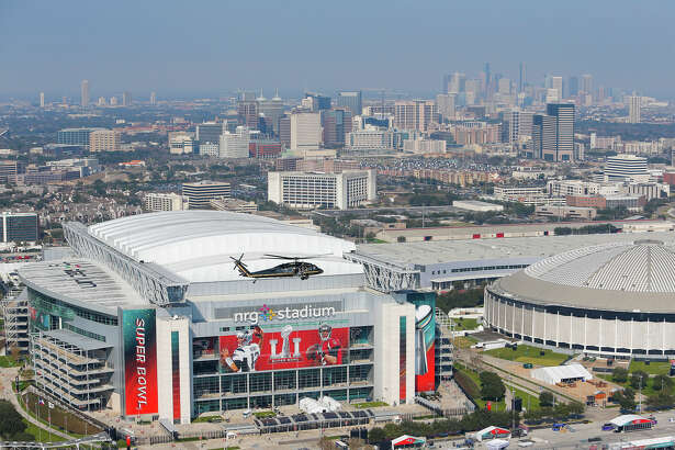 A Customs and Border Protection UH-60 Black Hawk helicopter flies over NRG Stadium before Super Bowl LI Thursday, Feb. 2, 2017 in Houston. On Sunday a total of five Customs and Border Protection helicopters and three airplanes will be enforcing a temporary flight restriction for aircraft within a 30 mile radius of NRG Stadium. ( Michael Ciaglo / Houston Chronicle )