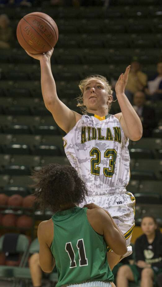 Midland College's Caley Barnard goes up for a shot over Clarendon College's Aleiyah Brantley Monday 02-06-17 at the Chaparral Center. Tim Fischer/Reporter-Telegram Photo: Tim Fischer/Midland Reporter-Telegram