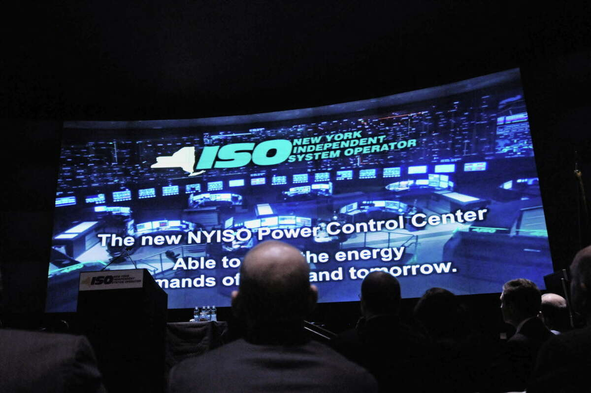 Visitors to the unveiling of the NYISO control center watch a video presentation at the start of the event on Tuesday, April 15, 2014, in North Greenbush, N.Y. (Paul Buckowski / Times Union)