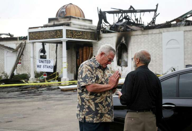 Bill Pozzi, left, who was a district-level delegate to the 2016 Republican National Convention, offers his help and condolences  to Shahid Hashmi, the president of the Victoria Islamic Center, Thursday, Feb. 2, 2017, in Victoria. An overnight fire destroyed the center on Jan. 28. ( Jon Shapley / Houston Chronicle )