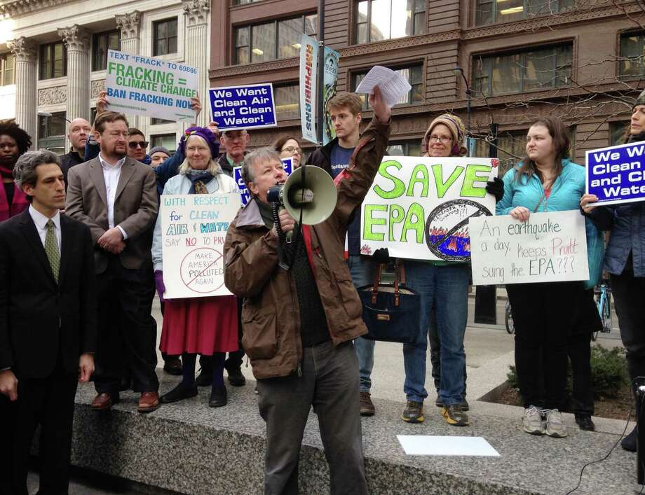 U.S. Environmental Protection Agency chemist Wayne Whipple speaks to a crowd gathered in Chicago, Monday, Feb. 6, 2017, to protest the nomination of Scott Pruitt for administrator of the agency. Pruitt is President Donald Trump's pick to head the agency. EPA employees and environmental activists attended the rally during the lunch hour. (AP Photo/Carla K. Johnson) Photo: Carla K. Johnson, STF / Copyright 2017 The Associated Press. All rights reserved.
