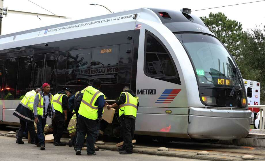 METRO Transit employees work to jack up a METRO Rail that hit and killed a female bicyclist at the intersection of Fannin Street and Sunset Boulevard next to Herman Park on Friday, February 3, in Houston. ( Yi-Chin Lee/ Houston Chronicle) Photo: Yi-Chin Lee / Houston Chronicle, METROL Rail / Houston Chronicle 2017