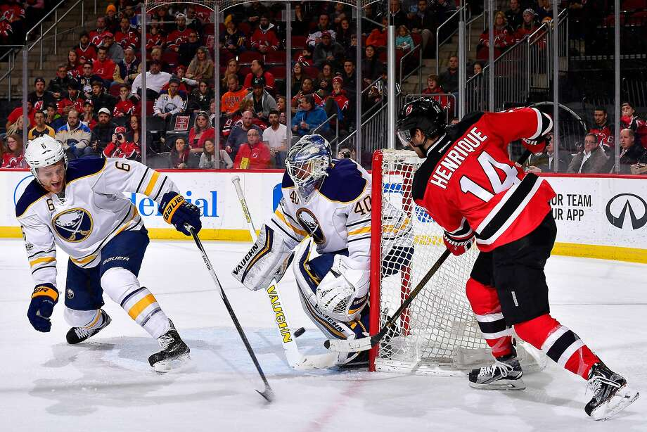 NEWARK, NJ - FEBRUARY 06: Adam Henrique #14 of the New Jersey Devils deflects the puck off of Cody Franson #6 of the Buffalo Sabres for a second period goal past Robin Lehner #40 at Prudential Center on February 6, 2017 in Newark, New Jersey.  (Photo by Steven Ryan/Getty Images) Photo: Steven Ryan, Getty Images