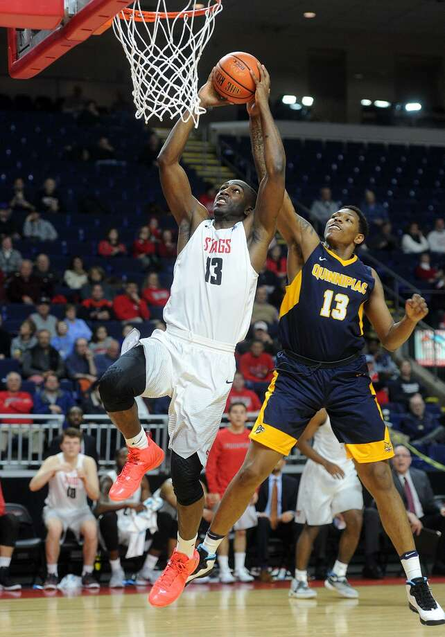 Fairfield's Jonathan Kasibabu drives for a fast-break basket ahead of Quinnipiac defender Chaise Daniels on Monday at the Webster Bank Arena. Photo: Brian A. Pounds / Hearst Connecticut Media / Connecticut Post