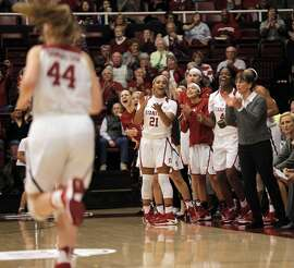 The Stanford bench celebrates a score in the first half as the Stanford women played UCLA at Maples Pavilion in Stanford, Calif., on Monday, February 6, 2017.