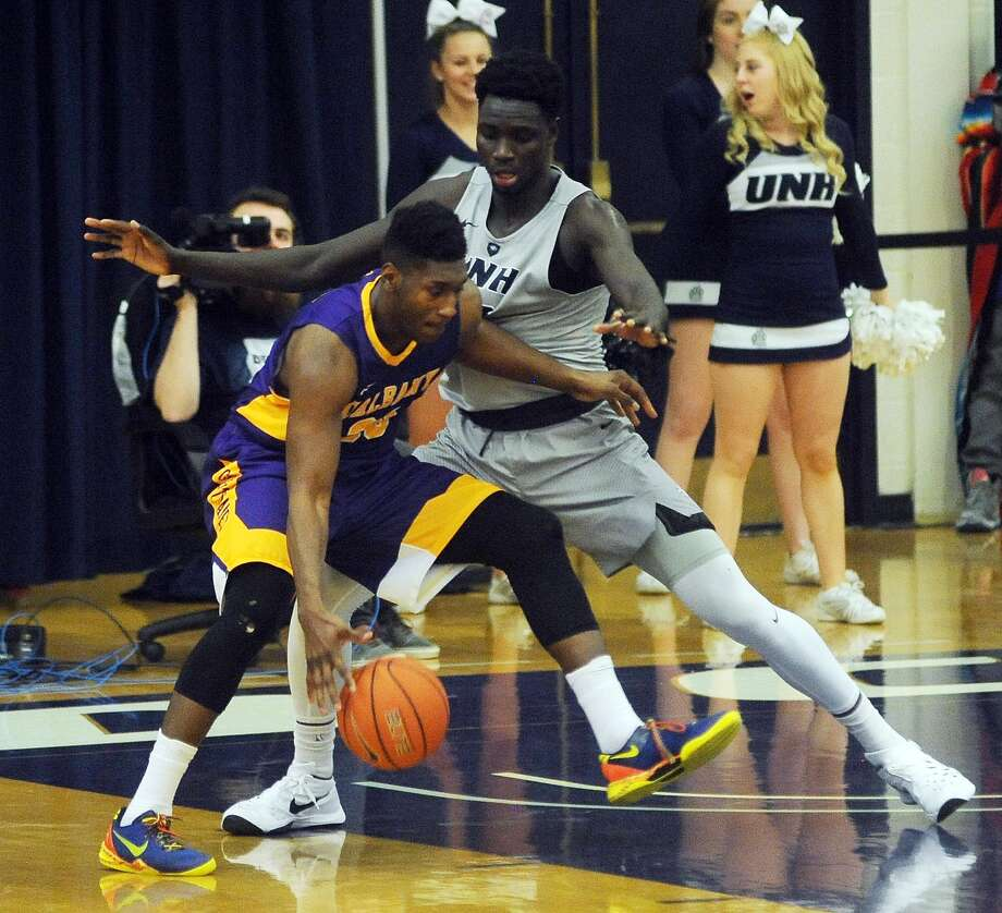 University of New Hampshire's Iba Camara, right, guards UAlbany's Travis Charles during the second half of their game Monday in Durham, N.H. UAlbany won 69-55. (Mark Bolton / New Hampshire Union Leader) Photo: Mark Bolton