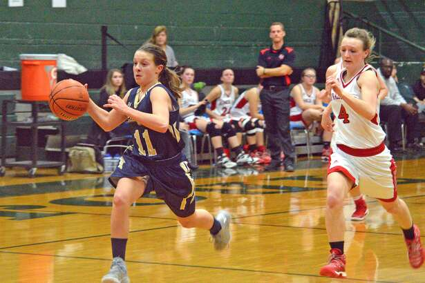 Father McGivney freshman Macy Hoppes drives to the basket during the third quarter of Monday's game against Bunker Hill at the Class 1A Madison Regional.