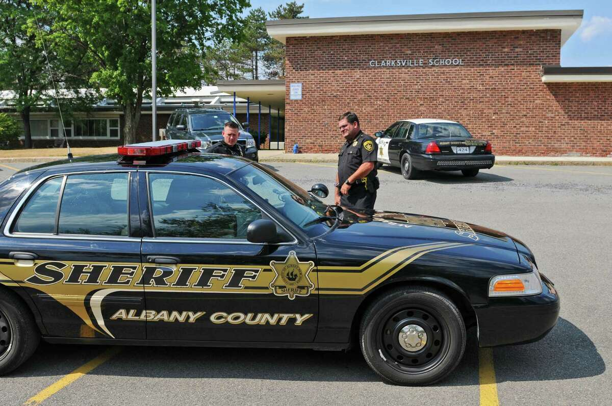 Albany County Sheriff's Office Deputy Chris Kopec, left, and Inspector Mark DeFrancesco outside of the former Clarksville Elementary Schoo on Thursday July 12, 2012 in Clarksville, NY. The school was closed by the Bethlehem School District because of declining enrollment. In 2021 Albany County will likely be building a new 911 center there as well. (Philip Kamrass / Times Union)