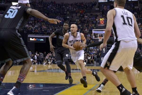 San Antonio Spurs guard Manu Ginobili, center right, drives past Memphis Grizzlies forward James Ennis, center left, in the second half of an NBA basketball game, Monday, Feb. 6, 2017, in Memphis, Tenn. (AP Photo/Brandon Dill)
