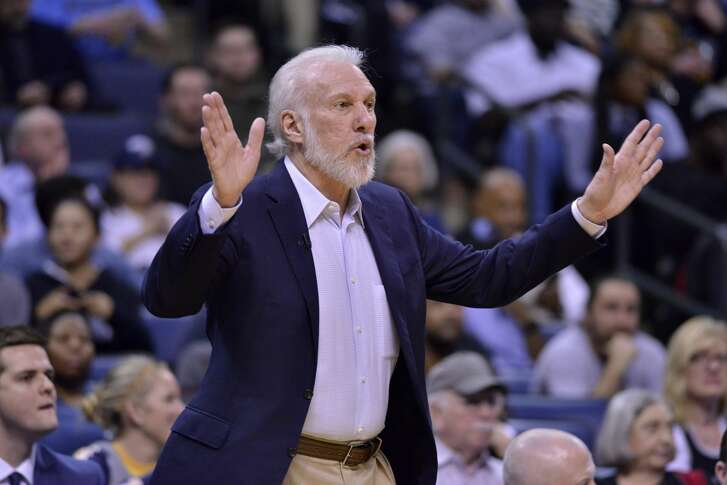 San Antonio Spurs head coach Gregg Popovich calls to players in the first half of an NBA basketball game against the Memphis Grizzlies, Monday, Feb. 6, 2017, in Memphis, Tenn. (AP Photo/Brandon Dill)