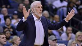 San Antonio Spurs head coach Gregg Popovich calls to players in the first half of an NBA basketball game against the Memphis Grizzlies, Monday, Feb. 6, 2017, in Memphis, Tenn. (AP Photo/Brandon Dill)