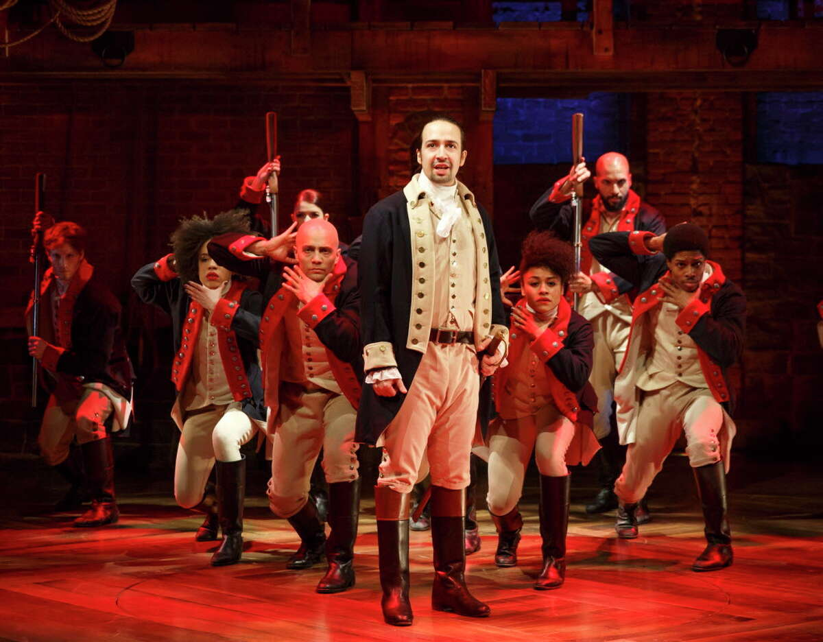 This image released by The Public Theater shows Lin-Manuel Miranda, foreground, with the cast during a performance of