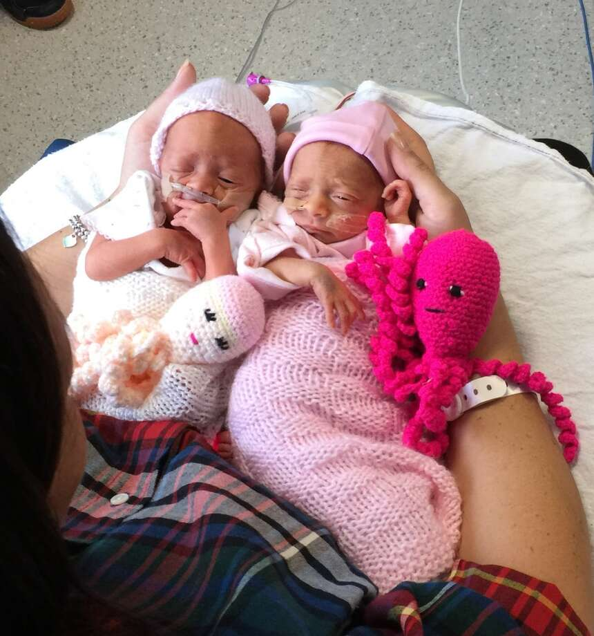 Mom, Kat Smith, with her daughters, Jasmine and Amber, and their octopi. Photo: Poole Hospital